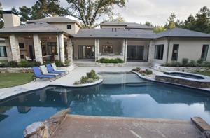 Texas-style outdoor living by the pool, by custom home builder Trent Williams, Tyler Texas