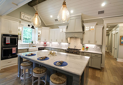 Beautiful white kitchen in a custom home in East Texas by Trent Williams Construction Management